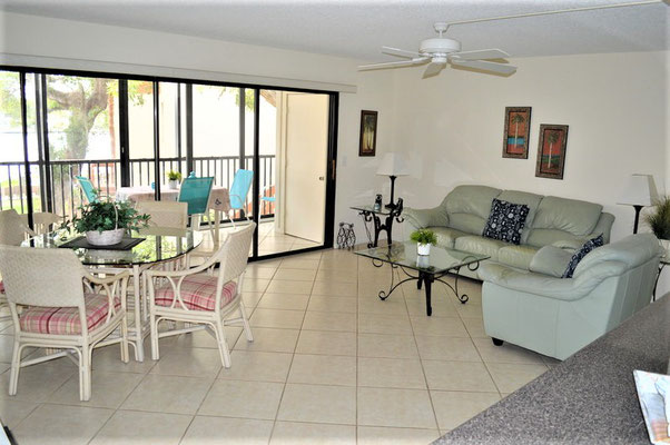 Living room with dining area Midnight Cove II Siesta Key
