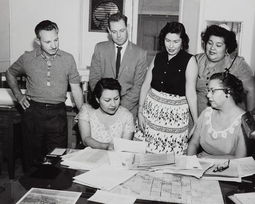 Discussing the Gruen master plan for Section 14, 1956. From left, standing, Ned Mitchell, Ben H. Southland; Gloria Gillette; and LaVerne Saubel; seated, Eileen Miguel and Vyola Olinger.