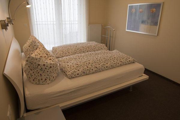 Strandpalais Duhnen Ferienwohnung Nr 20, Schlafzimmer mit Meerblick