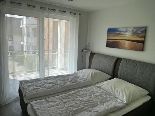 Schlafzimmer der Ferienwohnung in der Residenz Windjammer Duhnen