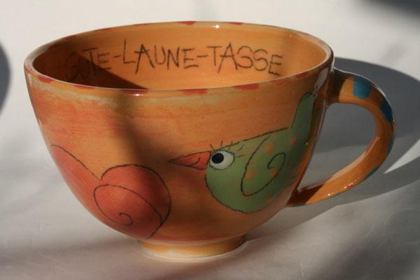 """Milchkaffeetasse """"Gute-Laune-Tasse"""" orange Artikelnummer 1703  /    22 €"""