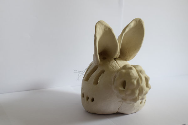 Rear view of ceramic rabbit house