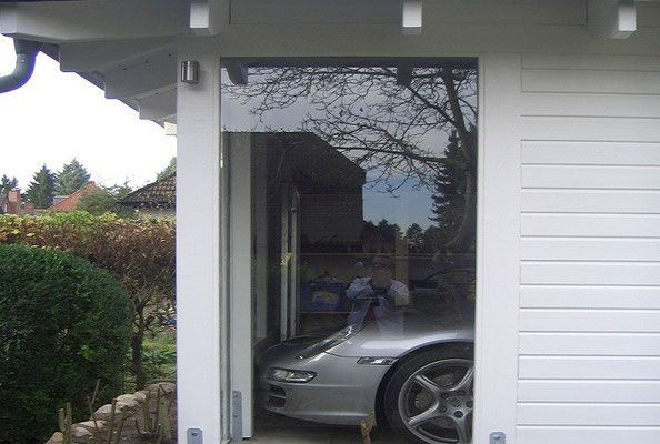 Walmdach Carport mit Glas Element
