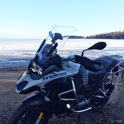 Winter riding in Finland. Lake behind has more than one meter thick ice. Some of the roads were rideable. Cold, very cold. :-)