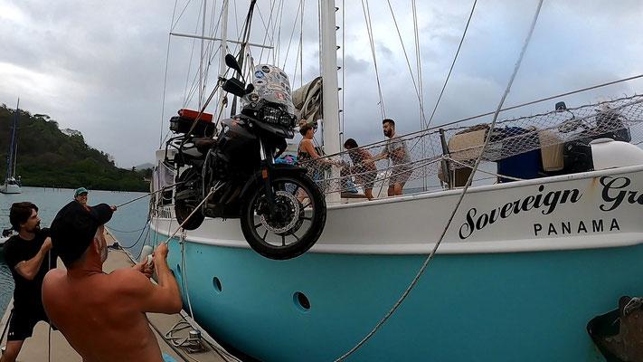 hoisting the bike on board to sail to south America
