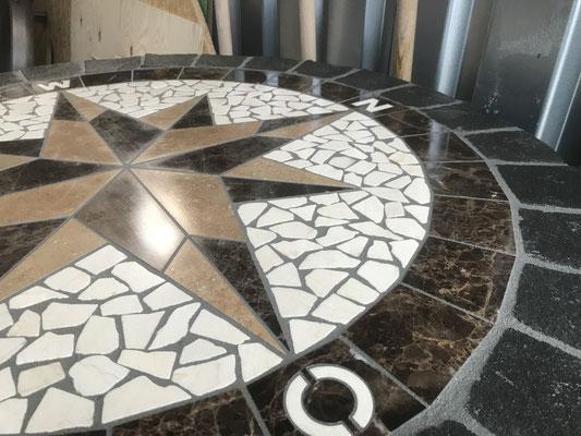 Freiburger Gartenbau Gelsomino - Pflasterarbeit - Ornament Kompass / Gesomino Design