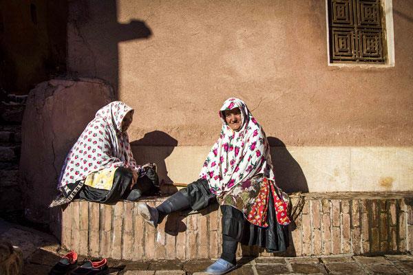 Two Women Conversing in Abyaneh Village.
