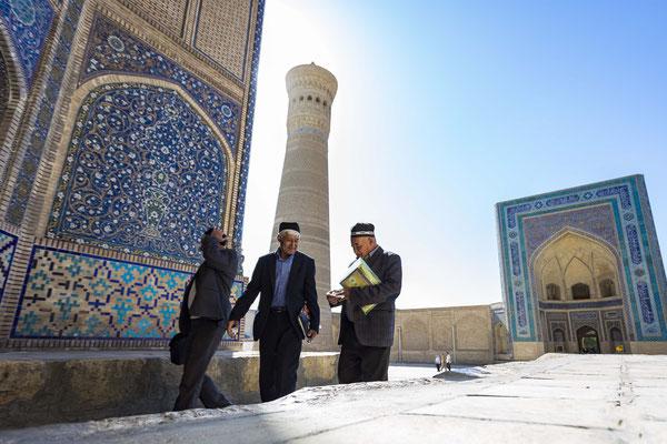 Scholars entering Mir-i Arab Madrassah in Bukhara.