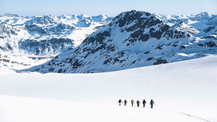 crossing the glacier plateau below Piz Buin