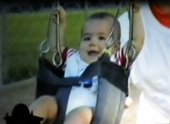 Baby Joe on a swing.