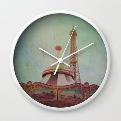 """Bohemia of Paris"" wall clock. Available in natural wood, black or white frames, our 10"" diameter unique Wall Clocks feature a high-impact plexiglass crystal face and a backside hook for easy hanging. Choose black or white hands"