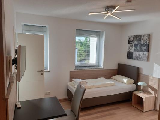 1-Bett-Apartment bei Elodie Serviced Apartments in Vaterstetten mit Blick ins Grüne