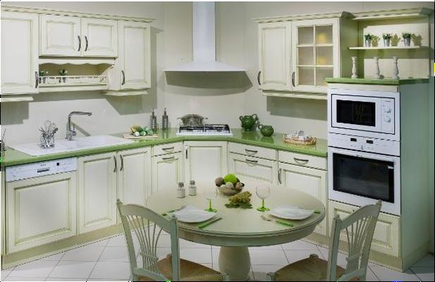 Implantation de la cuisson en angle - Plan de travail stratifié coloris vert pastel.