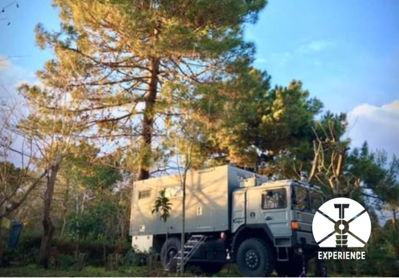 under the tree - secure living in expedition vehicles around the world - the best life style - just boondocking around and enjoying life
