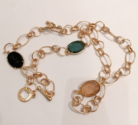Gold necklace with pink, black and blue stones