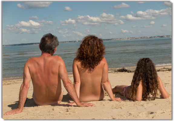 Family relax in front of Adriatic see