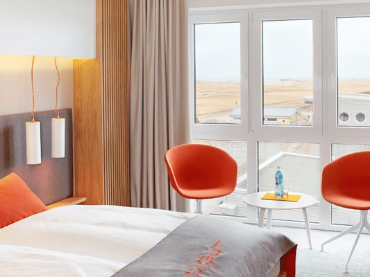Zimmerbeispiel StrandGut Resort St. Peter Ording,  MSC und MBSR helfen, um Stress zu vermeiden - Wege zum Sein