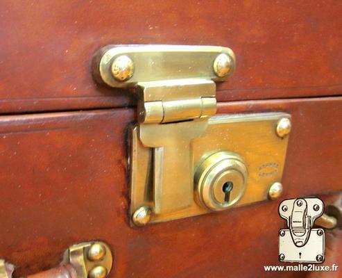 serrure poussoir valise Louis Vuitton sans marquage valise cuir