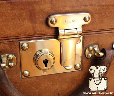 serrure poussoir valise Louis Vuitton valise cuir
