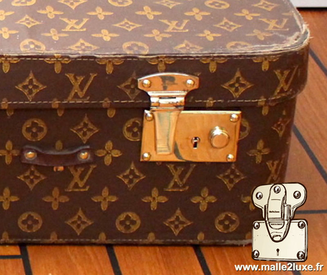 Louis Vuitton steel suitcase push lock souple