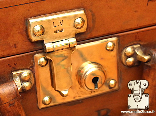 Louis Vuitton steel suitcase push lock brass polish