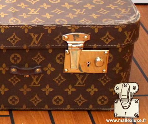 serrure poussoir valise Louis Vuitton bagage souple