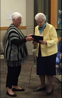 Mayor Pro Tem Sally Gruppen, left, presents a certificate of recognition to Dorothy Voss. Contributed