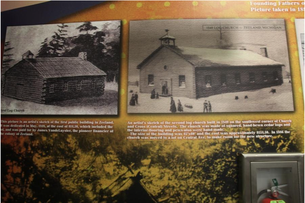 The log cabin churches from early in Zeeland's history are displayed on the historic photo wall at First Reformed Church. Erin Dietzer/Sentinel Staff