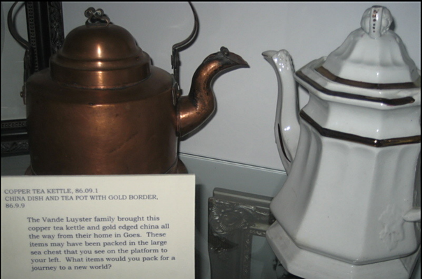 The Vande Luyster family brought this copper tea kettle and gold edged china all the way from their home in Goes, The Netherlands.