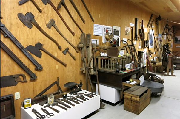 Tools and farming equipment fill the red barn located on the grounds of the Museum.