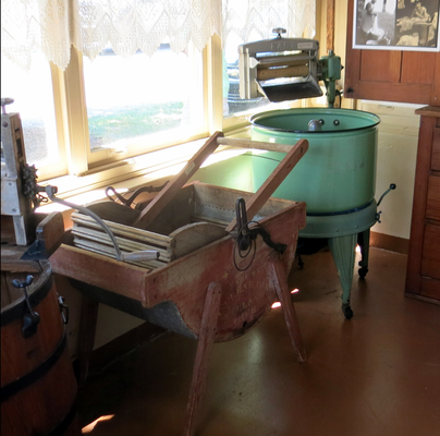 "The humbug washer - 1915. On the right is a 1923 early electric ""Easy"" Washing Machine."