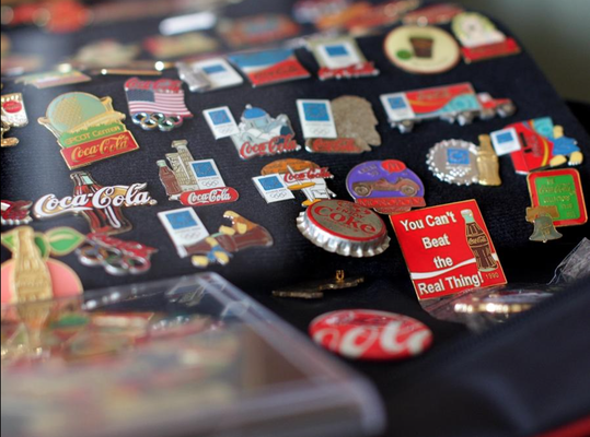 One of Ken Westveld's favorite Coca-Cola items to collect are pins. Rob Wetterholt Jr./Sentinel Staff