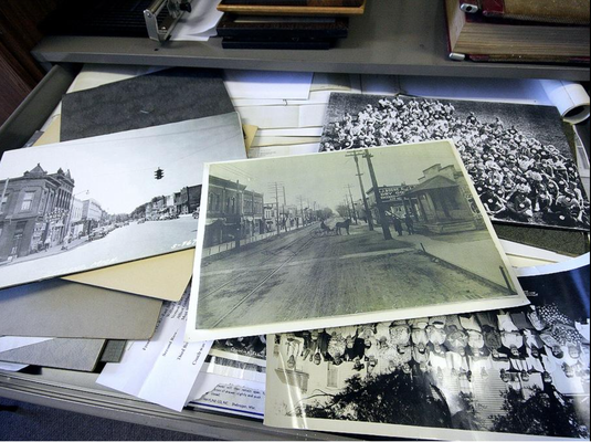 Large format photographs populate one of the drawers inside the Zeeland Historical Society. Rob Wetterholt Jr./Sentinel Staff