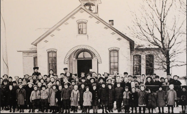 A photo of the school and students inside the newly renovated original New Groningen School. (Cory Olsen | The Grand Rapids Press)