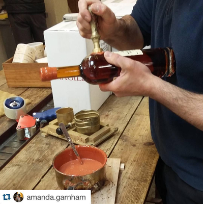 Hand-stamping the wax on Delord Armagnac bottles - Photo Courtesy of Amanda Garnham (Instagram)