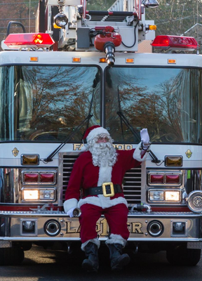 Santa arriving at the Tree Lighting Ceremony