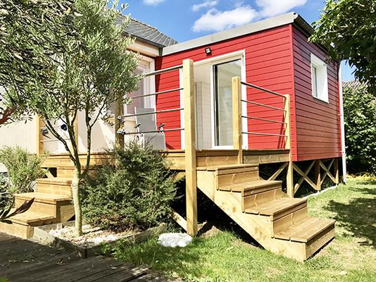 Terrasse en bois devant extension de maison