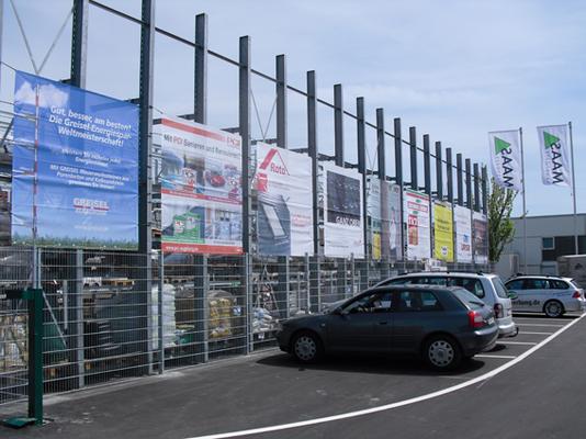 Blickwerbung Crailsheim - Bauzaunwerbung, Bannerwerbung, Banner gesäumt und geöst, Supermarkt, Baustoffhandel im Kreis Schwäbisch Hall