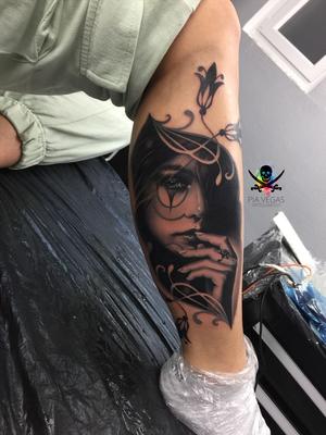 melancholy black and white leg tattoo