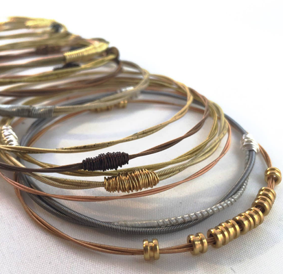guitar string jewelry restrung wire wrap wrapping bracelets necklaces funky unique different one of a kind small business gold silver chain gemstones crystals stones mens bangles cute delicate gift handmade music musician