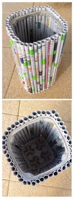 poubelle avec 2 porte-gobelets Mc Donalds et des vieux journaux