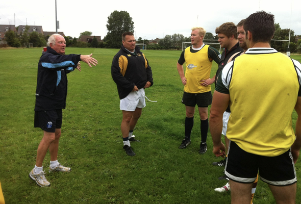 Ex England Coach Brian Ashton MBE gives a coaching session to The Wild Pigs