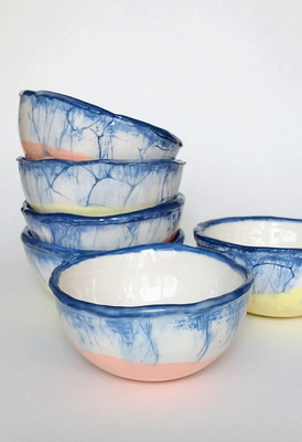 "These unique bowls are hand built in ""Jasmin"" earthenware. The native colour of the material is a gentle creamy white. They are coloured with cobalt blue and soft orange/yellow underglaze and finalised with transparent glazing."