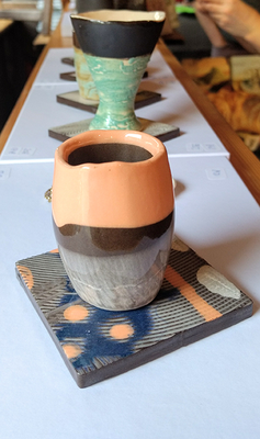 Small decorative tiles can be used as saucers for coffee cups or as coasters under glasses on delicate surfaces.