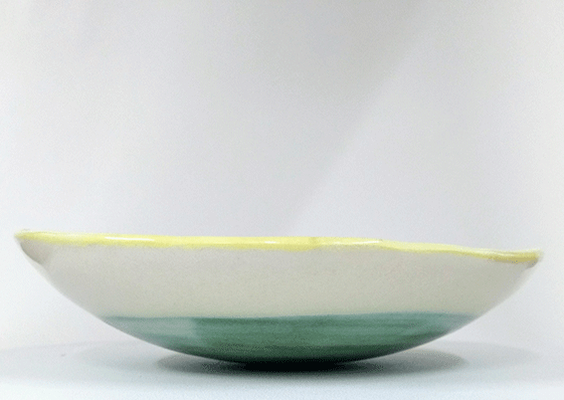 "This unique bowl/plate is slab built in ""Jasmin"" earthenware. The native colour of the material is a gentle creamy white. It is coloured inside with soft yellow underglaze and at the bottom, with several layers of underglazes and glazes."