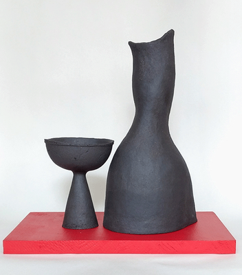 "The hand built ""African Stone"" stoneware  gobelet and carafe/vase are unglazed, which makes them unrefined and raw to the touch, in contrast with the design. Hand wash advised."