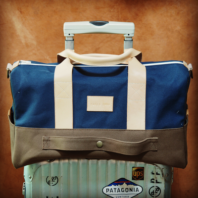 brown-blue-carry-on