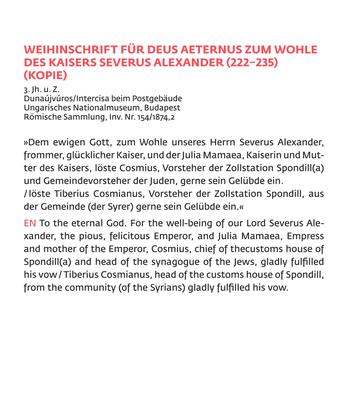 """Beschriftungen in mehreren Größen in der Ausstellung im """"Licht der Menora"""". Je nach Anbringung im unteren oder oberen Sichtfeld des Besuchers sowie nach Textart variieren die Schriftgrößen."""