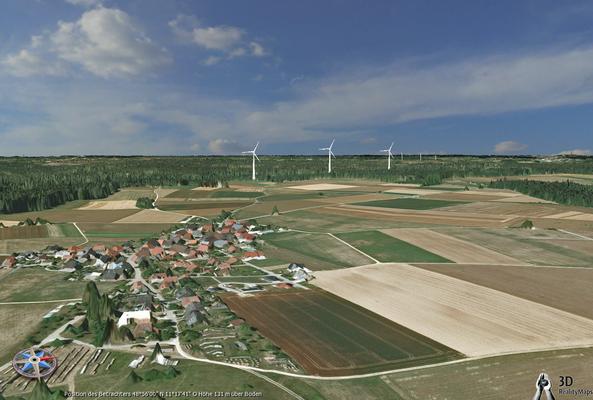 Blick in Richtung der Windräder mit Rapperszell im Vordergrund