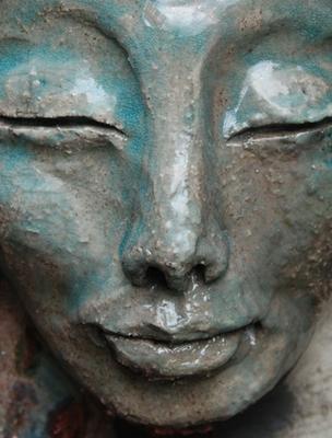 Tibetan Man Material: Ceramic  Technique: Japanese Raku  Colour: White/Turqouise/Copper